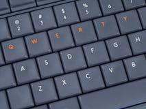 Grått tangentbord med markerade QWERTY knappar från överkant Royaltyfria Foton