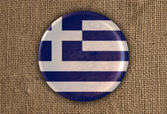Grécia Textured em volta da madeira da bandeira no pano áspero imagem de stock royalty free