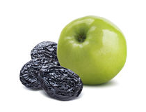 Grön äpplebaksida för helhet och torra plommoner royaltyfri foto