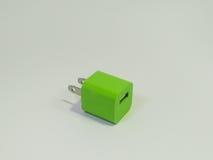 Grön adapterpropp royaltyfria foton