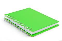 grön anmärkning för bok Arkivfoto