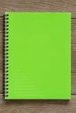 Grön anteckningsbok Royaltyfri Bild