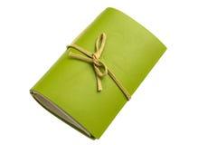 grön anteckningsbok Royaltyfria Bilder