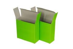 Grön ask två med locket isolerad ask för öppen eller dokument med olika förslagpacke Royaltyfri Foto