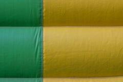 Grön bakgrund för detalj för gulingPVC-presenning fotografering för bildbyråer