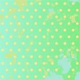 Grön bakgrund för Grunge med prickar Arkivfoto