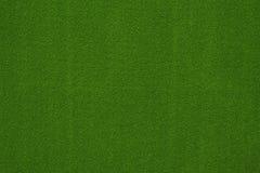Grön bakgrund för pokertabellfilt Arkivfoto