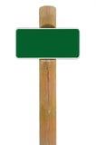Grön bakgrund för utrymme för kopia för signage för metallteckenbräde, vit ramroadsign, gammal åldrig riden ut träpolstolpe, isol Arkivbild