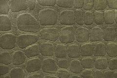 Grön bakgrund från mjukt stoppningtextilmaterial, closeup Tyg med mönstrar Royaltyfria Foton
