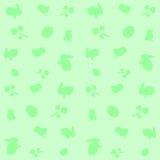 Grön bakgrund med symboler av påsken Royaltyfri Fotografi