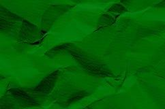 Grön bakgrund och tapet vid skrynklig pappers- textur och fre arkivfoto