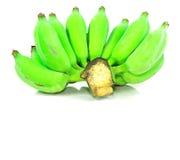Grön banan från trädgården som isoleras på vit bakgrund Arkivbild