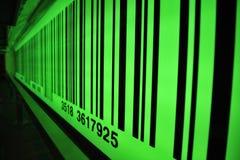 Grön barcode med den selektiva fokusen Fotografering för Bildbyråer