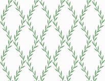 Grön blom- sömlös modell från sidor på vit Arkivbilder