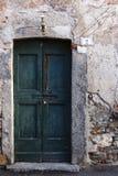 Grön dörr på nummer två, Pusiano Fotografering för Bildbyråer