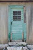 Grön dörrAssos kefalonia, Grekland Royaltyfria Bilder