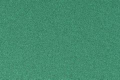 Grön dekorativ bakgrund för polyestertygtextur, slut upp Arkivfoto
