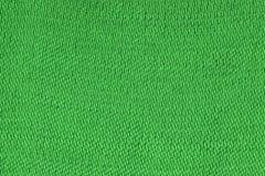 Grön dekorativ bakgrund för polyestertygtextur, slut upp fotografering för bildbyråer