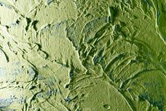 Grön dekorativ murbruk som en bakgrund Royaltyfri Foto