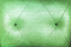 grön delsofa Arkivfoto