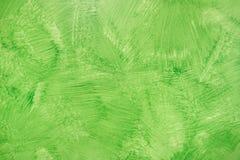 Grön ekologisk bakgrund - den målade Grungehanden texturerade väggen Royaltyfri Bild