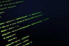 Grön en hackertext på svart Arkivfoton