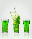 grön färgstänk för drink Arkivfoto