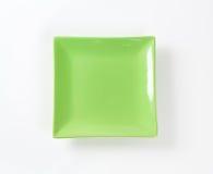 Grön fyrkantig platta royaltyfri foto
