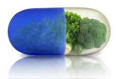 Grön grönsakvitaminpreventivpiller arkivbilder
