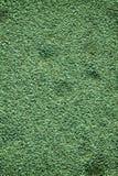 Grön granit vaggar closeupbakgrund, stentextur, knäckt yttersida Arkivbild