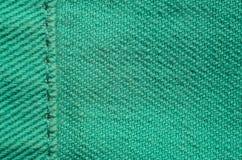 Grön grov bomullstvilltextiltextur Arkivbild