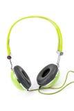 Grön hörlurar Arkivfoto