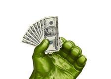 Grön hand och små pengar Fotografering för Bildbyråer