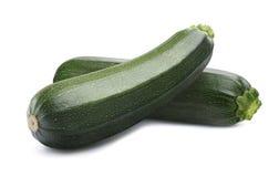 Grön hel zucchini som isoleras på vit bakgrund royaltyfri bild