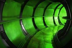 Grön industriell avloppsnättunnelinre Royaltyfri Foto