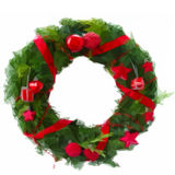 Grön julkrans med röda garneringar royaltyfri illustrationer