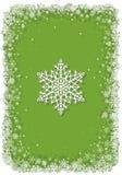 Grön julram med snöflingor Arkivfoton