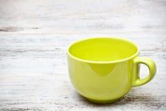 Grön kaffekopp arkivbilder