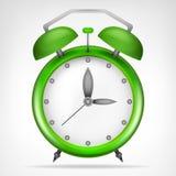 Grön klocka med objekt för rinnande tid Arkivbild