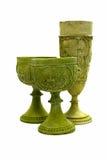 Grön kopp på vit bakgrund Arkivbild