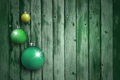 Grön kulauppsättning på åldrig träbakgrund Royaltyfria Foton