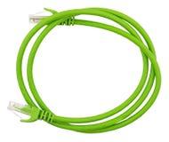 Grön LAN-kabel på vit fotografering för bildbyråer
