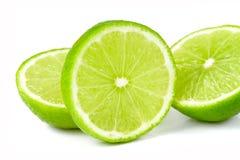 Grön limefrukt som isoleras på vit bakgrund royaltyfri bild