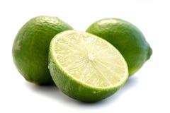 Grön limefrukt som isoleras på vit bakgrund royaltyfria foton