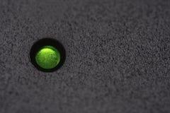 Grön makt för makro som LEDAS på svart plast- med copyspace royaltyfri foto