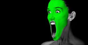 Grön maskering på kvinnaframsida Arkivfoto