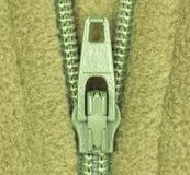 grön material zipper för ullbeklädnad Fotografering för Bildbyråer