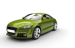 Grön metallisk bil Arkivbild