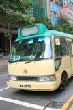 Grön minibuss i Hong Kong Arkivfoto