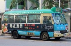 Grön minibuss i Hong Kong Royaltyfria Bilder